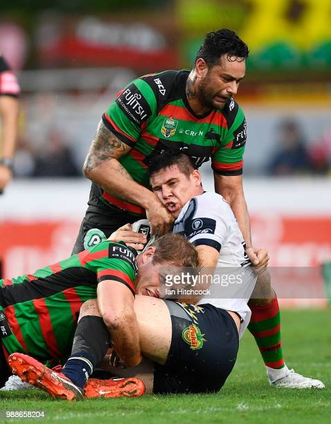 Shane Wright of the Cowboys is tackled during the round 16 NRL match between the South Sydney Rabbitohs and the North Queensland Cowboys at Barlow...