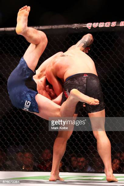 Shane Young of New Zealand is thrown by Alexander Volkanovski of Australia in their catchweight bout during the UFC Fight Night at Qudos Bank Arena...