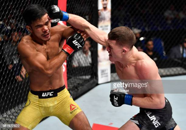 Shane Young of New Zealand punches Rolando Dy of Phillippines in their featherweight bout during the UFC Fight Night event at the Singapore Indoor...