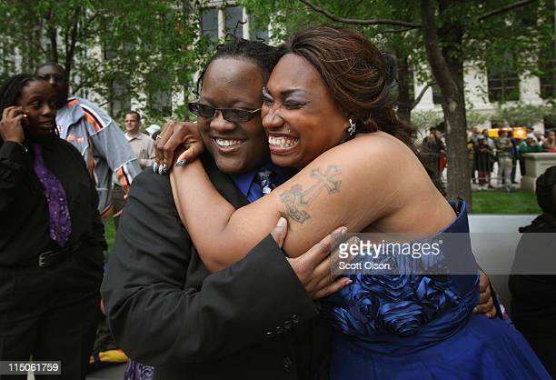 Shanelle Moffett and Tenisha Watkins embrace at their civil union ceremony in Millennium Park June 2 2011 in Chicago Illinois More than 30 samesex...