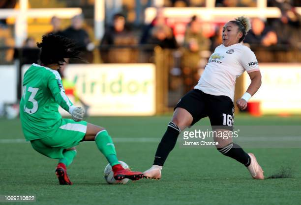 Shanelle Salgado of Crystal Palace saves from Lauren James of Manchester United Women during the FA Women's Championship match between Crystal Palace...
