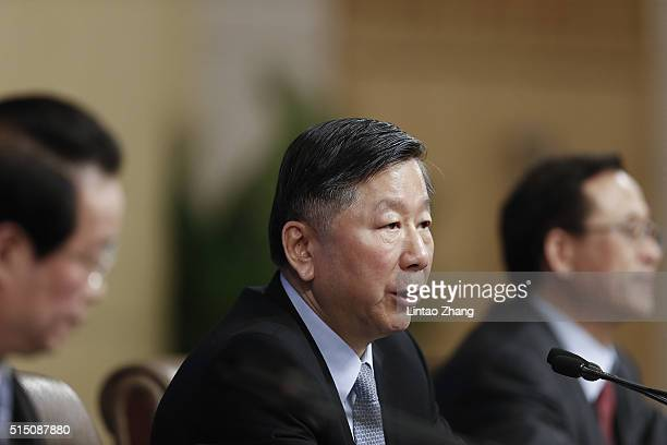 Shang Fulin Chairman of China Banking Regulatory Commission attends the a press conference held for the National People's Congress at the media...