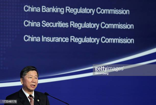 Shang Fulin chairman of the China Banking Regulatory Commission speaks at the Lujiazui Forum in Shanghai China on Saturday June 29 2013 China's...