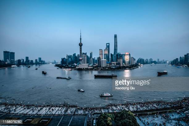 shanghai at dusk - huangpu river stock pictures, royalty-free photos & images