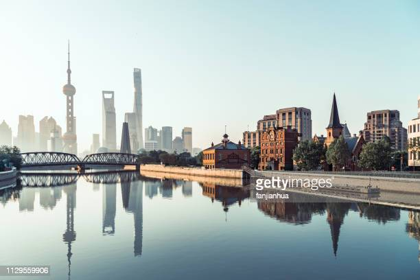 shanghai bund skyline with waibaidu bridge against sky - lujiazui stock pictures, royalty-free photos & images