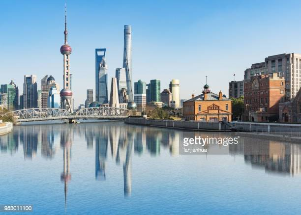 shanghai bund skyline with waibaidu bridge against sky - pudong stock pictures, royalty-free photos & images