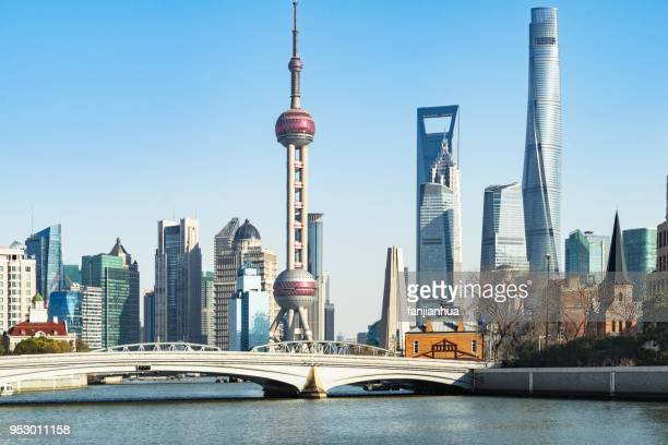 shanghai bund skyline with waibaidu bridge against sky - huangpu river stock photos and pictures