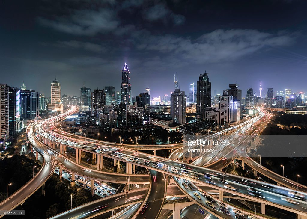 Shanghai, busy road intersection at dusk : Stock Photo