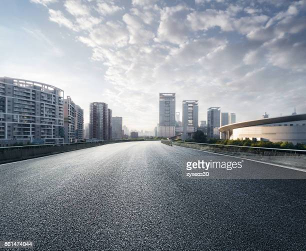 shanghai century avenue cityscape, - urban road stock pictures, royalty-free photos & images