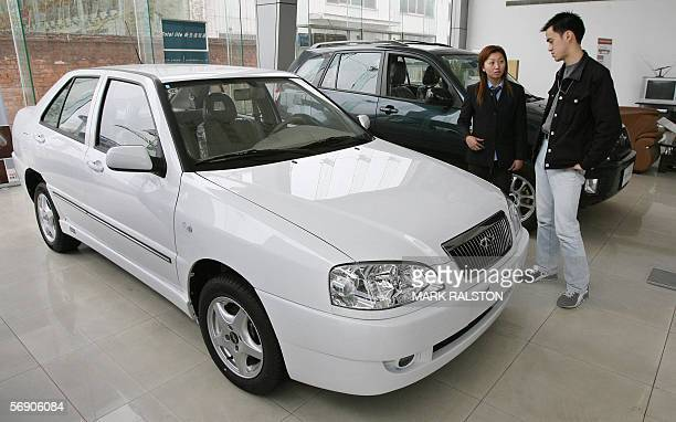A customer looks at a Chery car at a dealership of China's largest car exporter Chery Automobile in Shanghai 22 February 2006 The company which has...