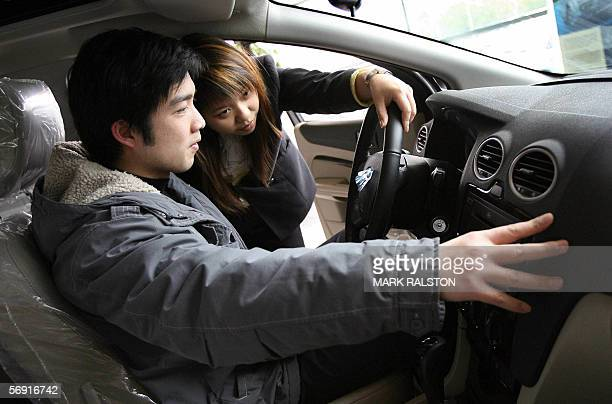 A customer tries out the latest Ford Focus Ghia car that sells for 20000 USD and is one of four models manufactured at the company's Chongqing joint...