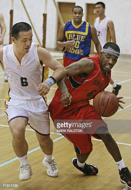 Player from the Chinese PLA navy team competes with a player from the visiting USS Blue Ridge navy ship team during a friendly basketball game, which...