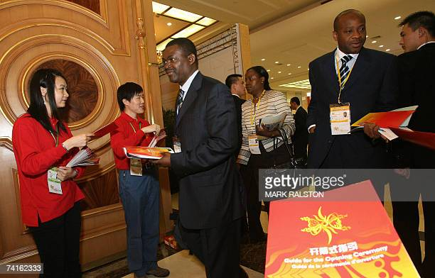 African and Chinese delegates arrive for the opening ceremony of the 2007 African Development Bank meeting in Shanghai 16 May 2007 Chinese Premier...