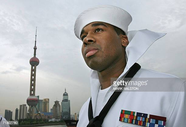 An American sailor from the USS Blue Ridge, views the city skyline after his ships arrival in Shanghai on a goodwill visit, 27 June 2006. The ship...