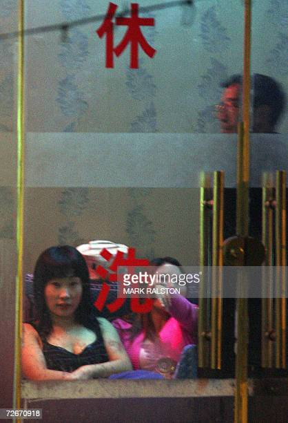 Chinese prostitutes wait for customers at a neighbourhood brothel in Shanghai 29 November 2006 The number of recorded HIV/AIDS infections in Shanghai...