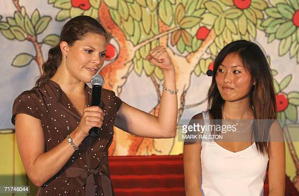 Crown Princess Victoria from Sweden is watched by her Chinese translator as she jokes before a performance of the play 'Pippi Longstocking' in...