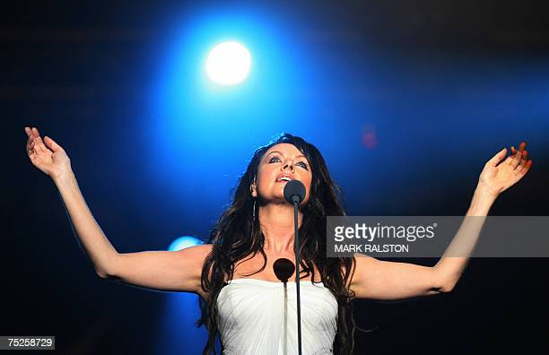 English singer Sarah Brightman performs before her set was cut short by thunderstorms during the Live Earth concert at the Oriental Pearl Tower in...