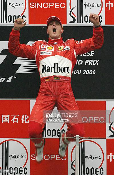 Ferrari driver Michael Schumacher of Germany leaps as he celebrates on the podium after winning the Chinese Grand Prix at the Shanghai International...