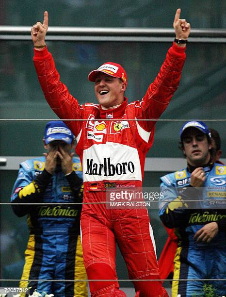 Ferrari driver Michael Schumacher of Germany celebrates on the podium after winning the Chinese Grand Prix at the Shanghai International Circuit 01...