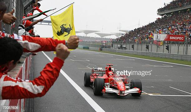 Ferrari Formula One driver Michael Schumacher of Germany crosses the finish line on his way to winning the China Grand Prix at the Shanghai...