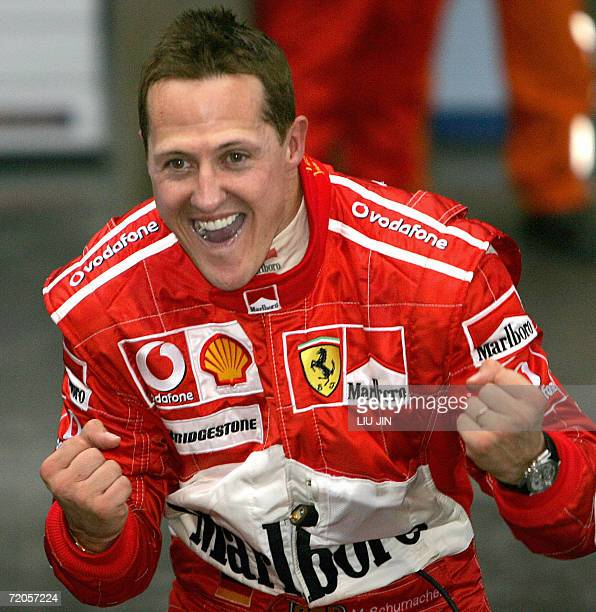 German Ferrari driver Michael Schumacher celebrates his victory after winning the Chinese Grand Prix at the Shanghai International Circuit 01 October...