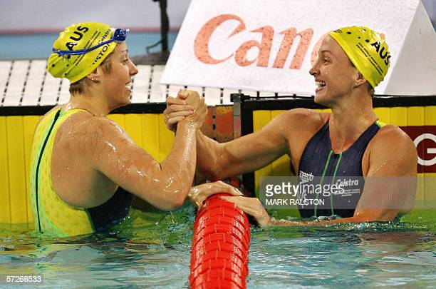 Jade Edmistone from Australia is congratulated by second place Brooke Hanson also from Australia after winning the Women's 50 metre breaststroke...