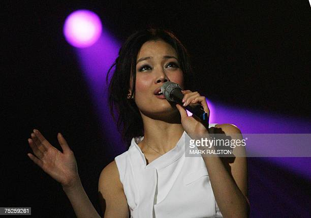 Joey Yung from Hong Kong performs during the Live Earth concert at the Oriental Pearl Tower in Shanghai 07 July 2007 An allday series of music...