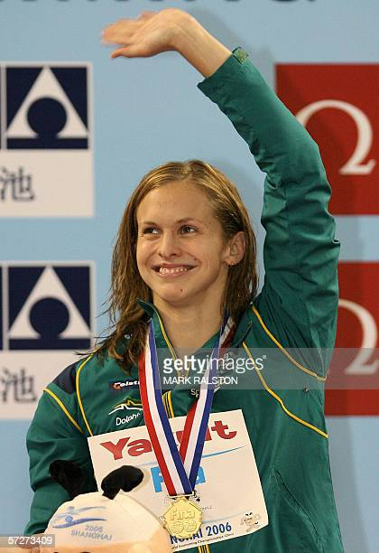 Lisbeth Lenton from Australia reacts after receiving her gold medal after winning the Women's 100 metre freestyle final in a time of 52.33, during...