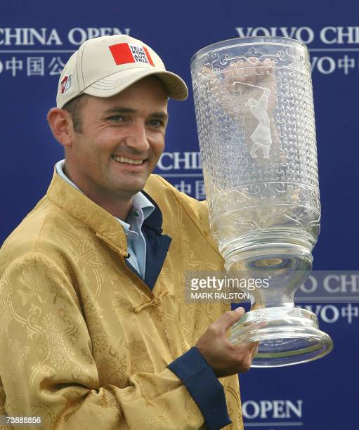 Markus Brier of Austria holds the Volvo China Open winner's trophy at the Silport Golf Club in Shanghai 15 April 2007 Brier finished 10 under par to...