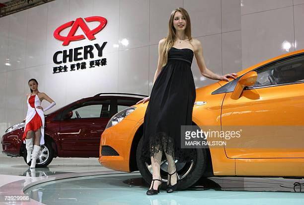 Models pose beside in a A6CC concept car by the Chinese manufacturer Chery, on display at the Auto Shanghai exhibition, 20 April 2007. The eight day...