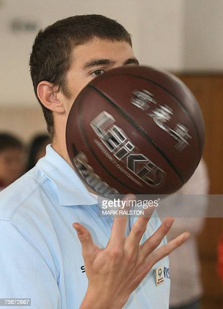 Olympic and World Swimming champion Michael Phelps plays basketball against disabled students from the Pudong Special Needs School in Shanghai 13...