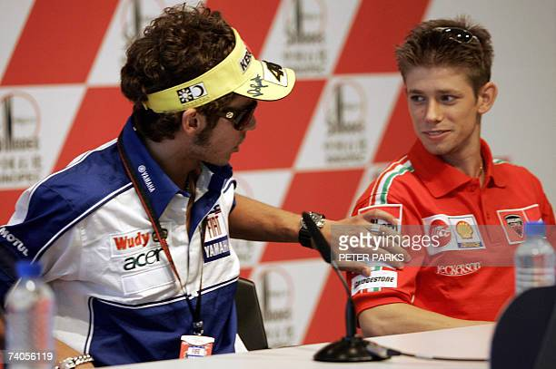 Seven time MotoGP World Champion Valentino Rossi of Italy chats with current championship leader Casey Stoner of Australia at a press conference for...