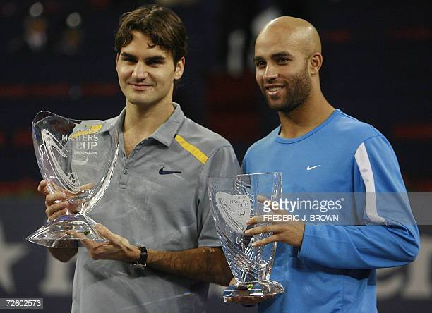 Switzerland's world number one player Roger Federer and James Blake hold their trophies following the Tennis Masters Cup final in Shanghai 19...