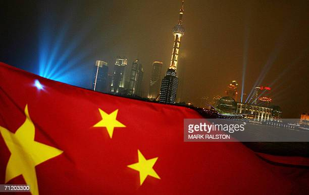 The Chinese flag flies in front of the Pudong skyline which is the site of the Shanghai Cooperation Organization meetings in Shanghai 14 June 2006...