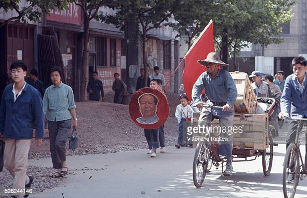 Shanghai Cina Children are shown around Shanghai with a red flag and a Mao Zedong's portrait May 25 1971