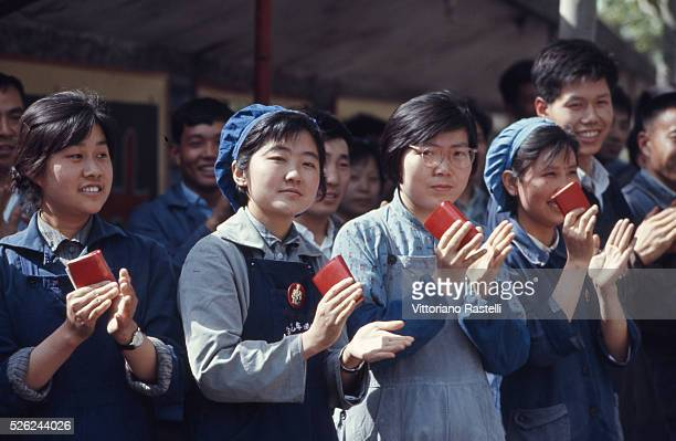 Shanghai Cina Factory workers hold Mao Zedong's Red Book in Shanghai May 24 1971
