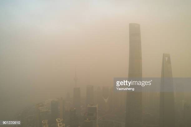shanghai city in heavy pollution day - smog stock pictures, royalty-free photos & images