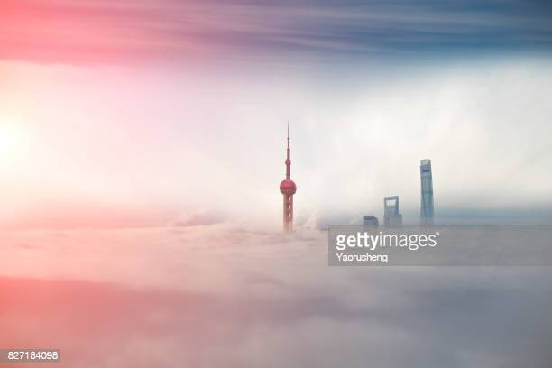 shanghai city scenery,lujiazui commerical buildings in the fog - wolkenkratzer stock-fotos und bilder