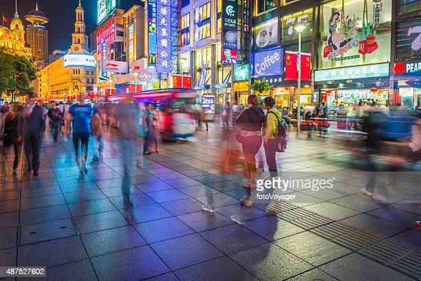 shanghai crowds shopping and strolling on colorful nanjing road china - brand name stock pictures, royalty-free photos & images