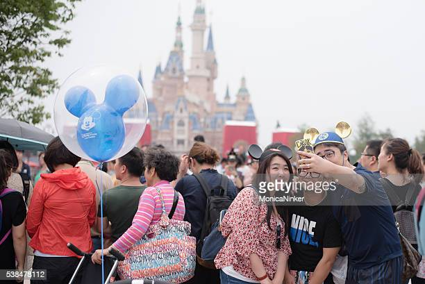 shanghai disneyland selfie - disney stock pictures, royalty-free photos & images