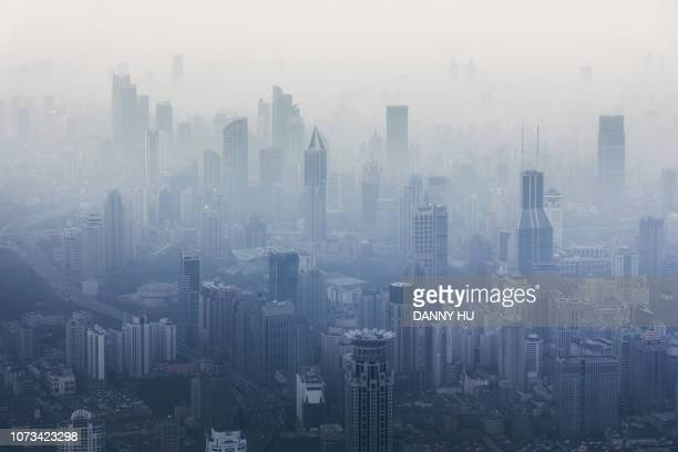 shanghai downtown in fog - smog stock pictures, royalty-free photos & images