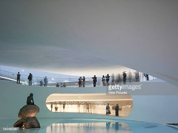 Shanghai Expo 2010 Danish Pavilion Big / Bjarke Ingels Group Shanghai 2010 Detailed Dusk View Of Little Mermaid In Pond With Water Reflection And...