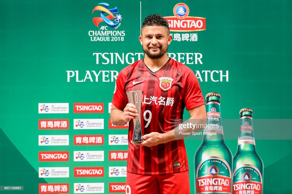 Shanghai FC Forward Elkeson de Oliveira Cardoso (C) celebrating with his trophy of best match player during the AFC Champions League 2018 Group Stage F Match Day 5 between Shanghai SIPG and Kawasaki Frontale at Shanghai Stadium on 04 April 2018 in Shanghai, China.
