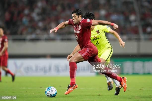 Shanghai FC Forward Givanildo Vieira De Sousa fights for the ball with Urawa Reds Defender Endo Wataru during the AFC Champions League 2017...