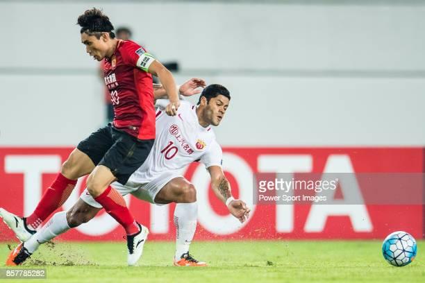 Shanghai FC Forward Givanildo Vieira De Sousa in action against Guangzhou Midfielder Zheng Zhi during the AFC Champions League 2017 QuarterFinals...