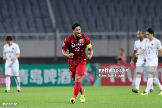 Shanghai FC Forward Hulk celebrates scoring a goal during the AFC Champions League Round of 16 match between Shanghai SIPG v Kashima Antlers at the...