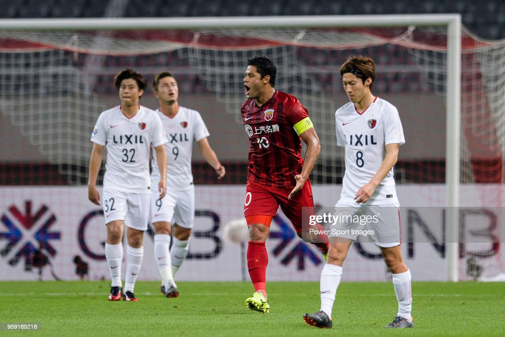 Shanghai FC Forward Hulk (C) celebrates scoring a goal during the AFC Champions League Round of 16 match between Shanghai SIPG v Kashima Antlers at the Shanghai Stadium on May 16, 2018 in Shanghai, China.