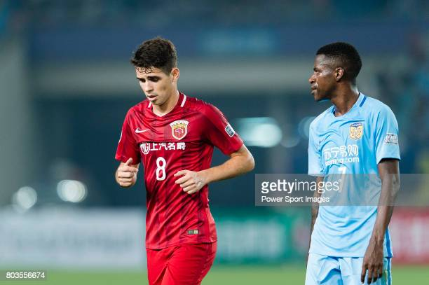 Shanghai FC Forward Oscar Emboaba Junior and Jiangsu FC Midfielder Ramires Santos during the AFC Champions League 2017 Round of 16 match between...