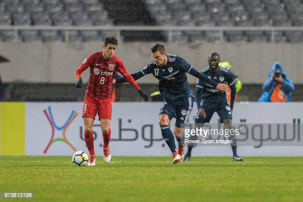 Shanghai FC Forward Oscar Emboaba Junior in action against Melbourne Defender James Donachie during the AFC Champions League Group F match between...