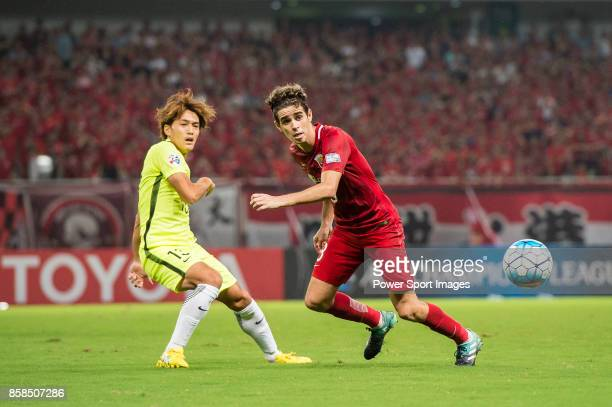 Shanghai FC Forward Oscar Emboaba Junior in action against zUrawa Reds Forward Takagi Toshiyuki during the AFC Champions League 2017 SemiFinals match...